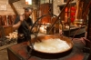 Churning the sugar syrup and clearing off scum