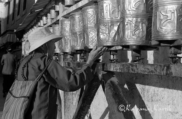Turning the prayer wheels in Lhasa, Tibet
