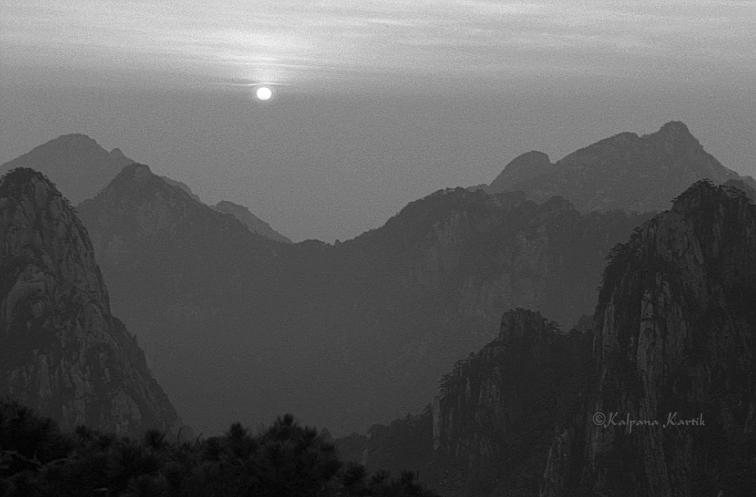 As the sun rises illuminating the dark corners of the mystic mountains ...