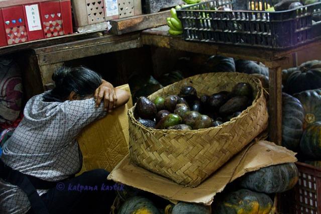 Fruit seller at Badung market Denpasar Bali
