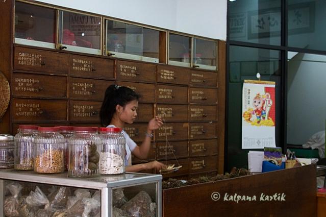 Woman preparing herbal medicine in Chinatown Jakarta