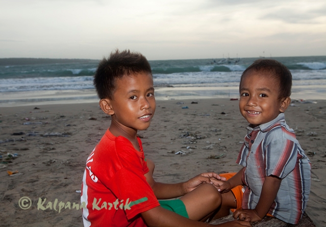 Smiling children along Jimbaran Beach
