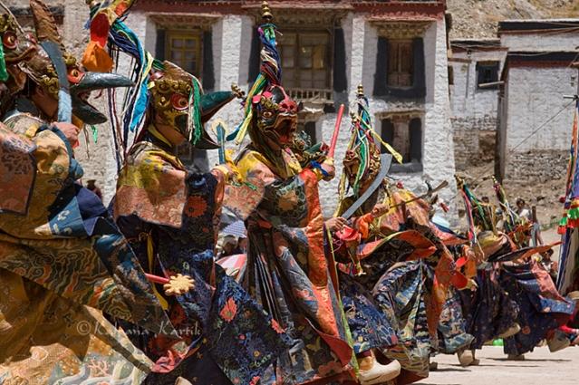 Lamas wearing masks performing the ritual dance at the Gyantse monastery