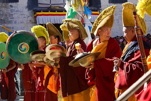 Lamas playing musical instruments at the Saga Dawa ceremony in Gyantse