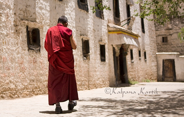 A monk walking in one of the streets of Sera monastery compound