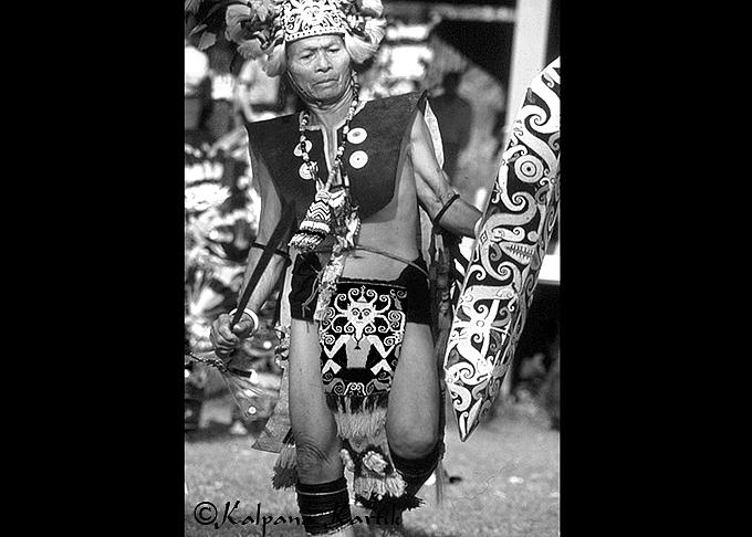 A dancing Kenyah Dayak holding his Mandau sword
