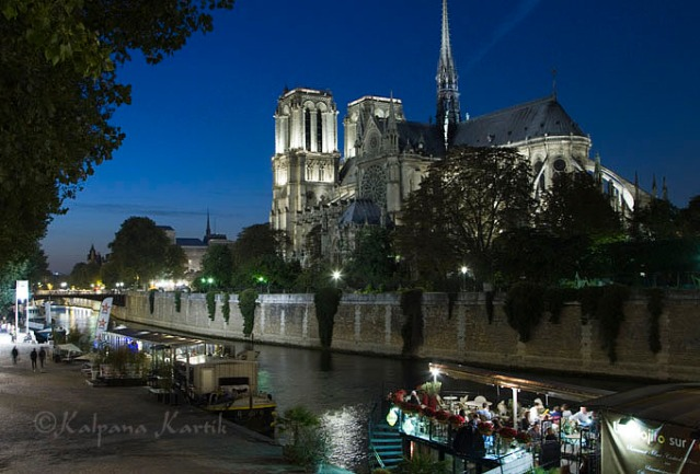 Notre Dame glistening against the twilight hour