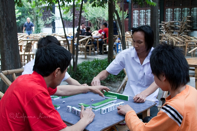Playing games  in Renmin Tea House Chengdu