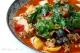 Toxo chicken vegetable stew Uyghur specialty served at Dolan Restaurant in Paris