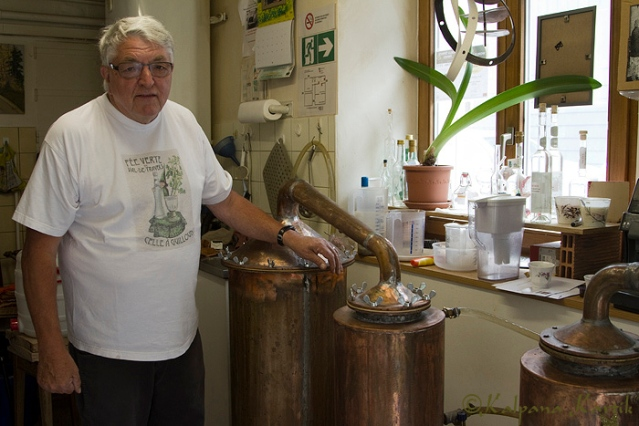 Daniel Guilloud in front of his home made distillery in his home boutique in Fleurier, Switzerland