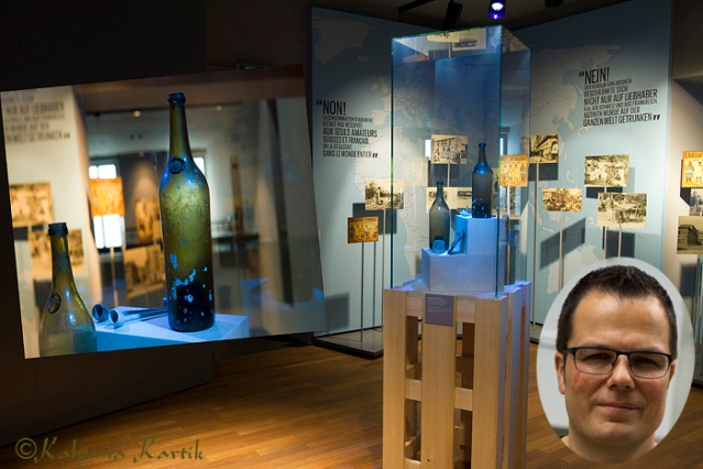 Yann Klauser director of La Maison de l'Absinthe and the display of Absinthe bottles recuperated from the wreckage of the Marie Thérèse