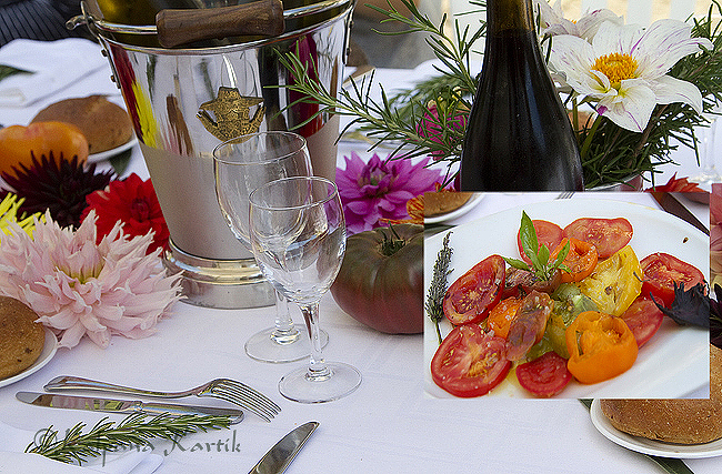 Garden dining with tomatoes specialties including tomato bread, ratatouille, fresh tomato salad ...
