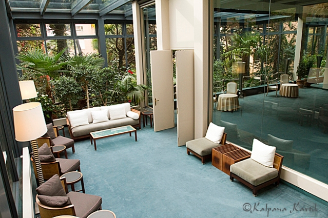 The outdoor veranda overlooking a tropical green house leading to an oriental style meeting room