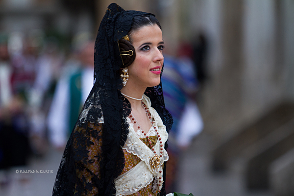 Falleras dressed in Valencian traditional dress march towards the Basilica for the flower offerings during Fallas