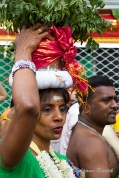 Woman carrying pot of milk while participating in the holy procession of Lord Ganesha