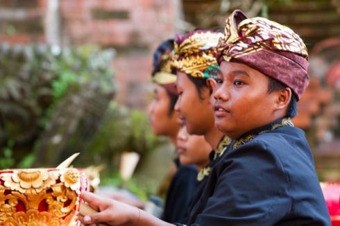 enjoying playing the gamelan